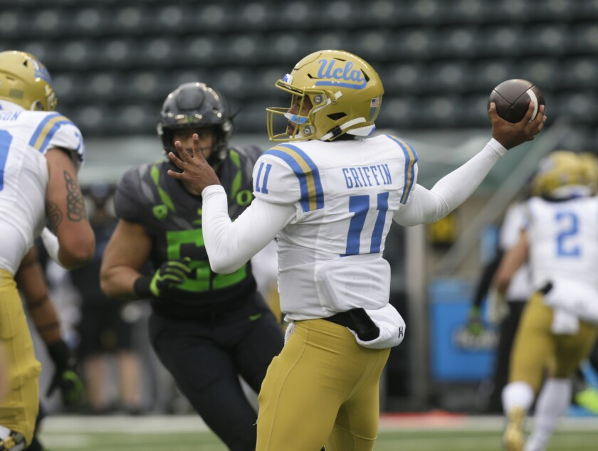 UCLA's Chase Griffin throws downfield against Oregon during the second quarter Nov. 21, 2020, in Eugene, Ore.