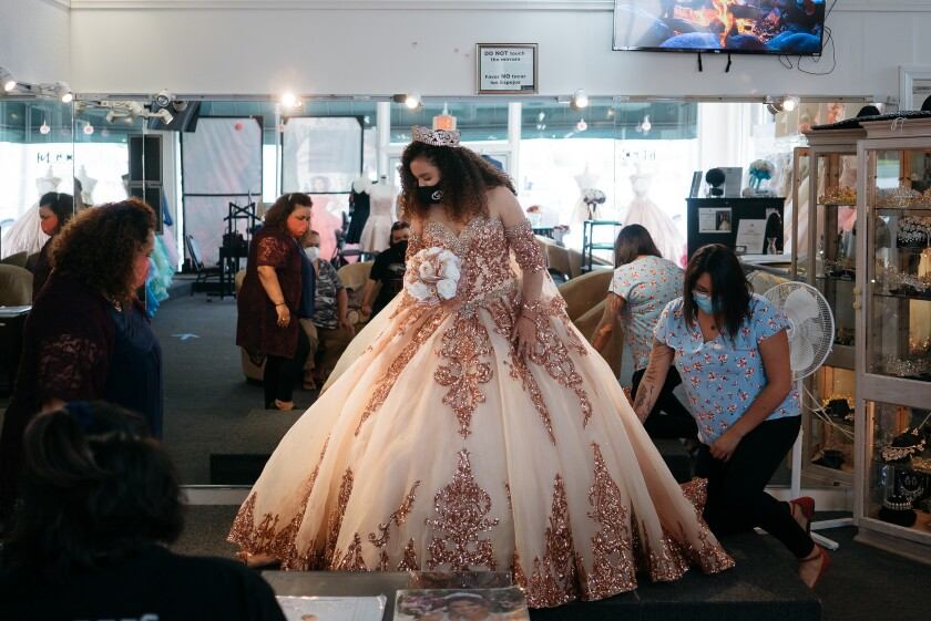 Hennessey De La Cruz is fitted for her quinceanera dress at Lily's Creations in Chula Vista.