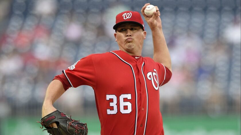 Washington Nationals relief pitcher Sammy Solis delivers a pitch during the sixth inning of the continuation of a suspended baseball game, Monday, June 18, 2018, in Washington.