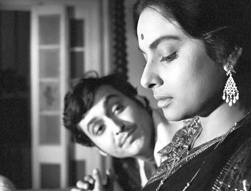 "Soumitra Chatterjee and Madhabi Mukherjee in ""Charulata."""