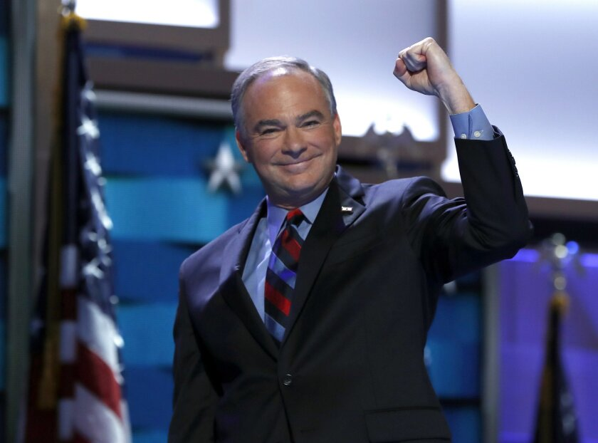 Democratic vice presidential candidate, Sen. Tim Kaine, D-Va., pumps his arm as he takes the stage during the third day session of the Democratic National Convention in Philadelphia, Wednesday, July 27, 2016. (AP Photo/Carolyn Kaster)