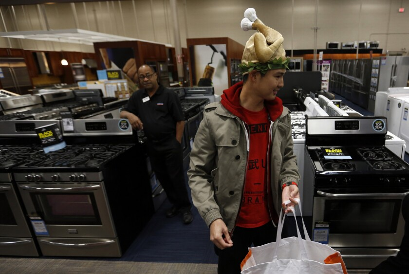 Wearing a turkey hat, Bryan Sato shops at a Best Buy in Los Angeles on Thanksgiving 2015.