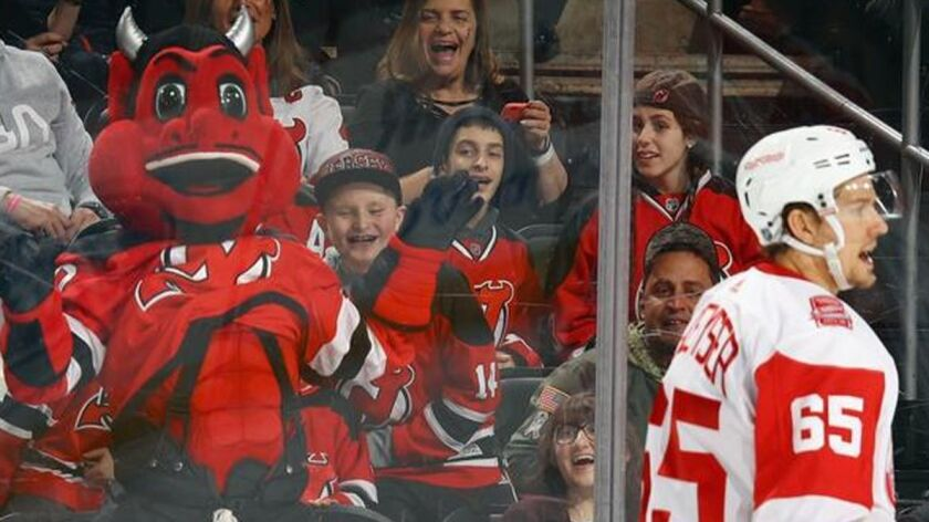 detailed look d603b 22e09 New Jersey Devils mascot shatters a giant window at a ...
