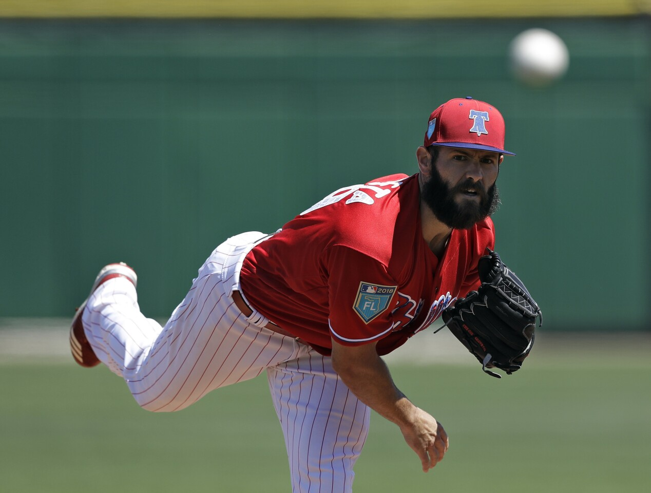 Phillies starting pitcher Jake Arrieta warms up before a spring training game against the Tigers on March 22, 2018, in Clearwater, Fla.