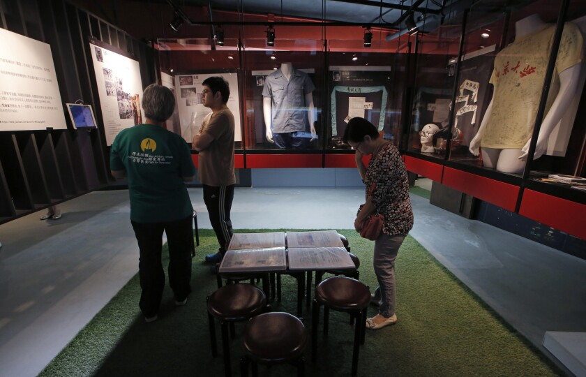 Visitors look at the exhibits in the June 4th Museum in Hong Kong on April 15, 2016.