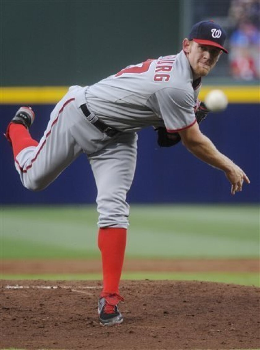 Washington Nationals starting pitcher Stephen Strasburg works against the Atlanta Braves during the first inning of a baseball game, Monday, April 29, 2013, in Atlanta. (AP Photo/John Amis)