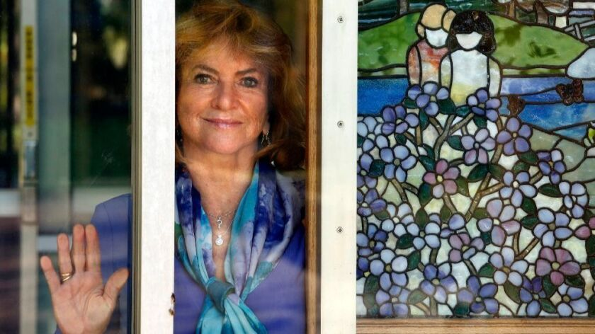 Dr. Yvonne Bryson, one of the foremost experts on pediatric AIDS, stands next to a stained-glass mural at the Marion Davies Children's Clinic at UCLA in Westwood.