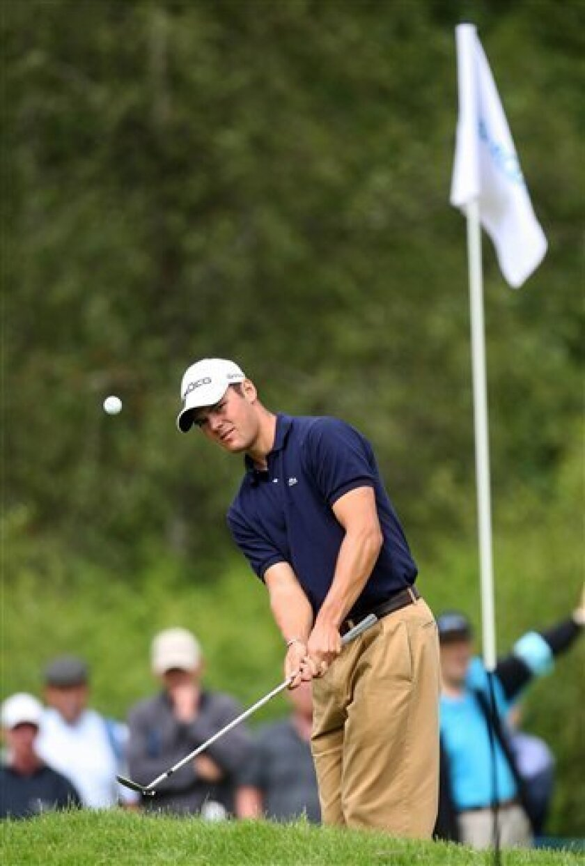 Germany's Martin Kaymer plays an approach to the 10th green during the final round of the Scottish Open golf tournament at Loch Lomond, Scotland, Sunday July 12, 2009. (AP Photo/PA, Lynne Cameron)