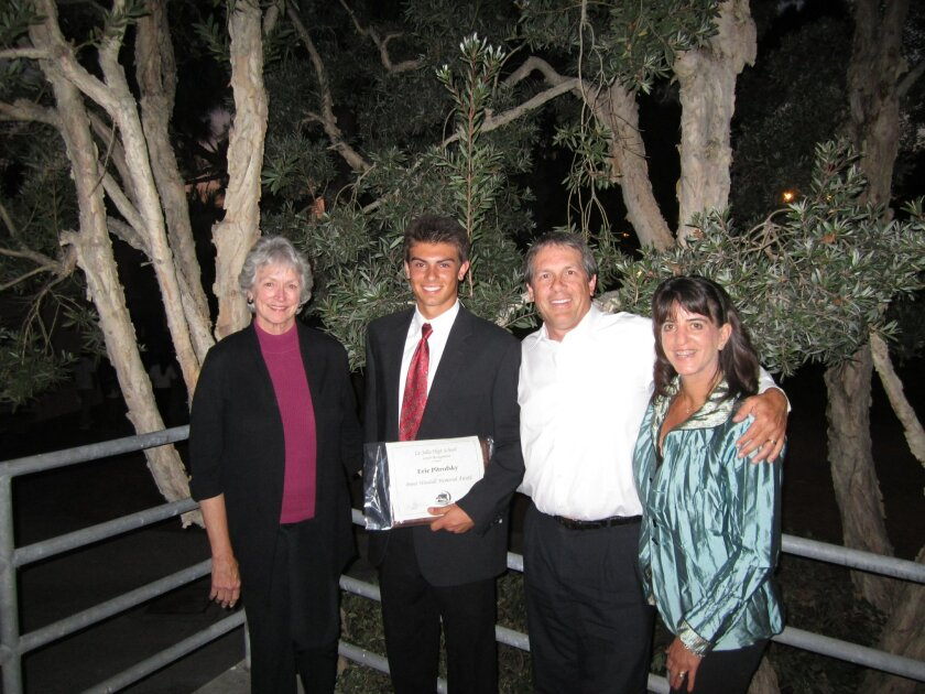 Eric Pitrofsky (second from left) poses with his mother, Vera Pitrofsky (far right), and Brent Woodall's parents after receiving the memorial award. COURTESY