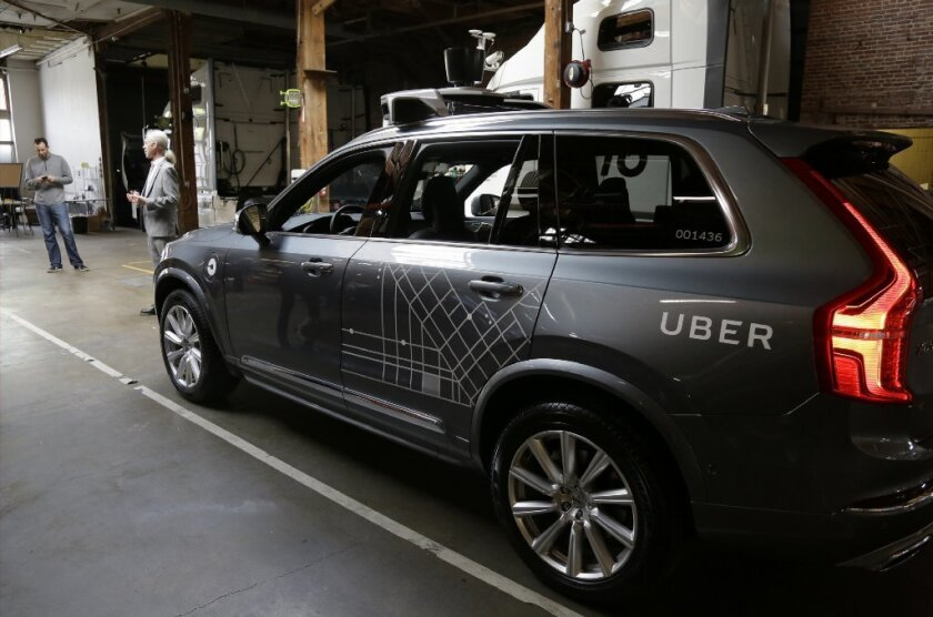 An Uber self-driving car is displayed in a garage in San Francisco.