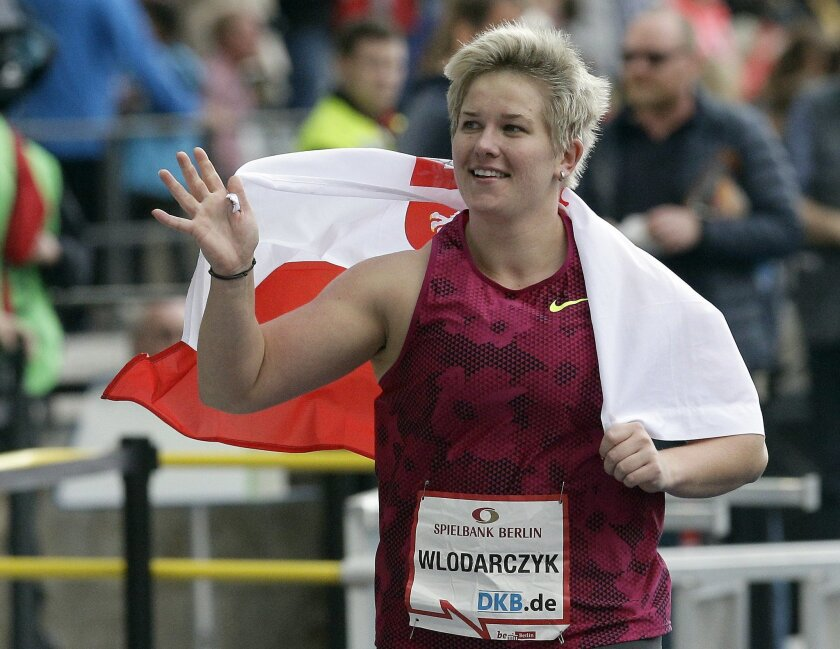 Anita Wlodarczyk from Poland celebrates winning the women's hammer throw competition at the ISTAF Athletics Meeting in Berlin, Germany, Sunday, Aug. 31, 2014. Wlodarczyk set a new world record with 79.58 meters. (AP Photo/Michael Sohn)