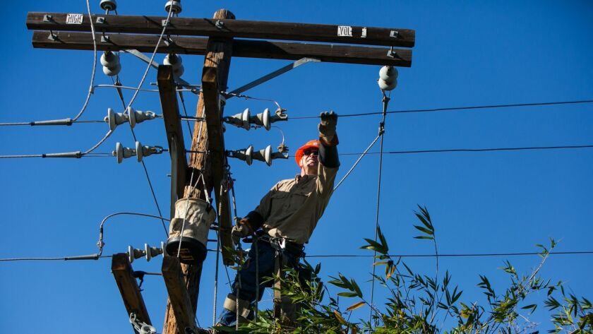 LOS ANGELES, CALIF. -- THURSDAY, DECEMBER 25, 2014: Power line patrolman Michael McGuire repairs the