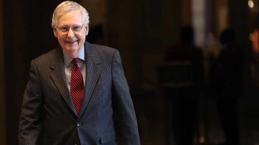 Senate Majority Leader Mitch McConnell walks to the Senate floor on Jan. 31 for a vote on legislation opposing President Trump's intention to withdraw U.S. troops from Afghanistan and Syria.