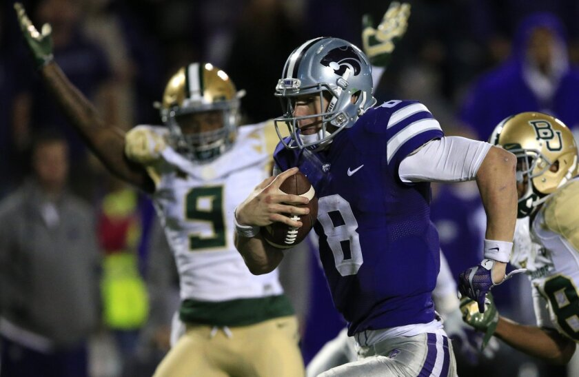 Kansas State quarterback Joe Hubener (8) runs for a touchdown past Baylor cornerback Ryan Reid (9) during the second half of an NCAA college football game in Manhattan, Kan., Thursday, Nov. 5, 2015. Baylor defeated Kansas State 31-24. (AP Photo/Orlin Wagner)