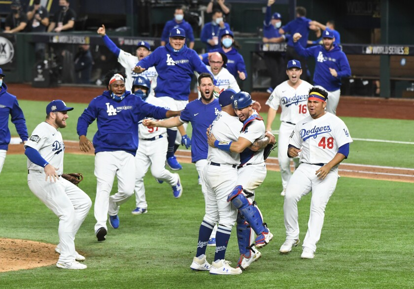 Baseball players hugging and jumping in the air
