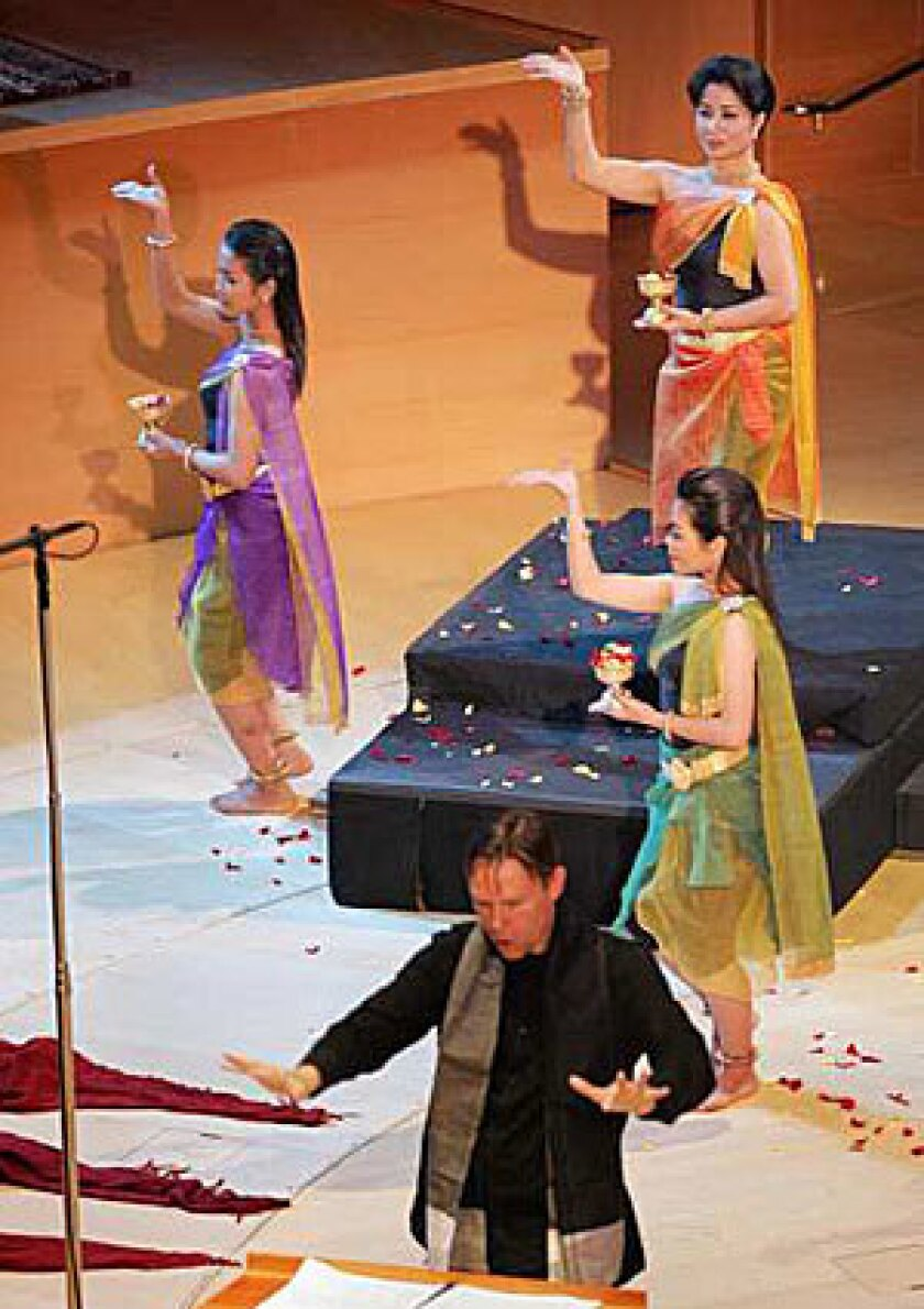 """GORGEOUS: Cambodian dancers perform as Grant Gershon leads the Los Angeles Master Chorale in Chinary Ung's """"Spiral XII: Space Between Heaven and Earth"""" at Walt Disney Concert Hall."""