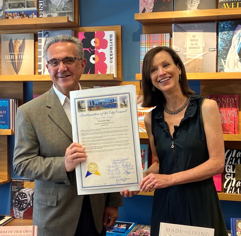 San Diego Councilman Joe LaCava gives a proclamation to Warwick's bookstore owner Nancy Warwick declaring Warwick's Day.