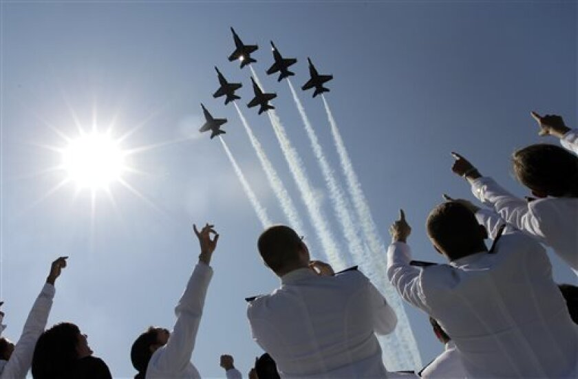 FILE - In a Tuesday, May 29, 2012 file photo, a formation of U.S. Navy Blue Angel fighter jets perform a flyover above graduating Midshipmen during the United States Naval Academy graduation and commissioning ceremonies in Annapolis, Md. The commander of Naval air forces announced on Tuesday, April