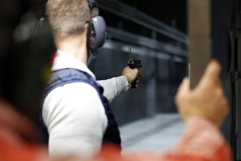 Chicago resident Ray Mandel practices shooting during a session at Maxon Shooter's Supplies and Indoor Range, Friday, A