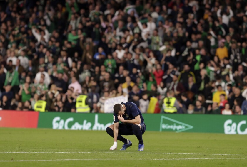 Real Madrid's Karim Benzema reacts at the end of La Liga soccer match between Betis and Real Madrid at the Benito Villamarin stadium in Seville, Spain, Sunday, March. 8, 2020. (AP Photo/Miguel Morenatti)