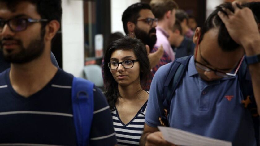 Student Iqra Memon, center, waits to talk to a representative from JP Morgan Chase on Sept. 6, 2018, after a recruiting presentation in the Science and Engineering Labs at the University of Illinois at Chicago.