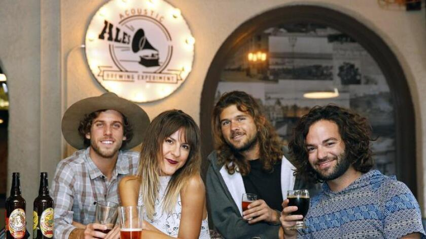 The Verigolds grab a brew at Acoustic Ales. From left: Eliot Ross, drinking 'Run for the Hills Double IPA', Jenna Cotton, drinking 'Run for the Hills Double IPA', , Ben Smedley, enjoying 'Strawberry Fields', and Craig Schreiber with 'Unplugged Imperial Chocolate Stout'. (Nancee E. Lewis)