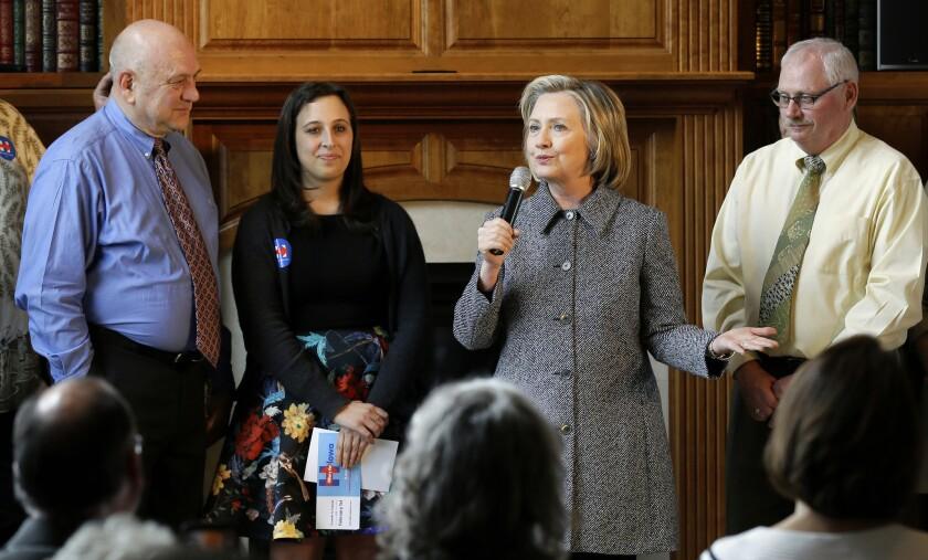 Hillary Rodham Clinton talks to supporters at a home in Mason City, Iowa.