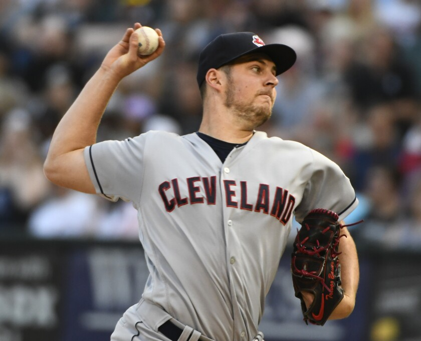 Cleveland Indians starting pitcher Trevor Bauer delivers against the Chicago White Sox during the first inning in Chicago.