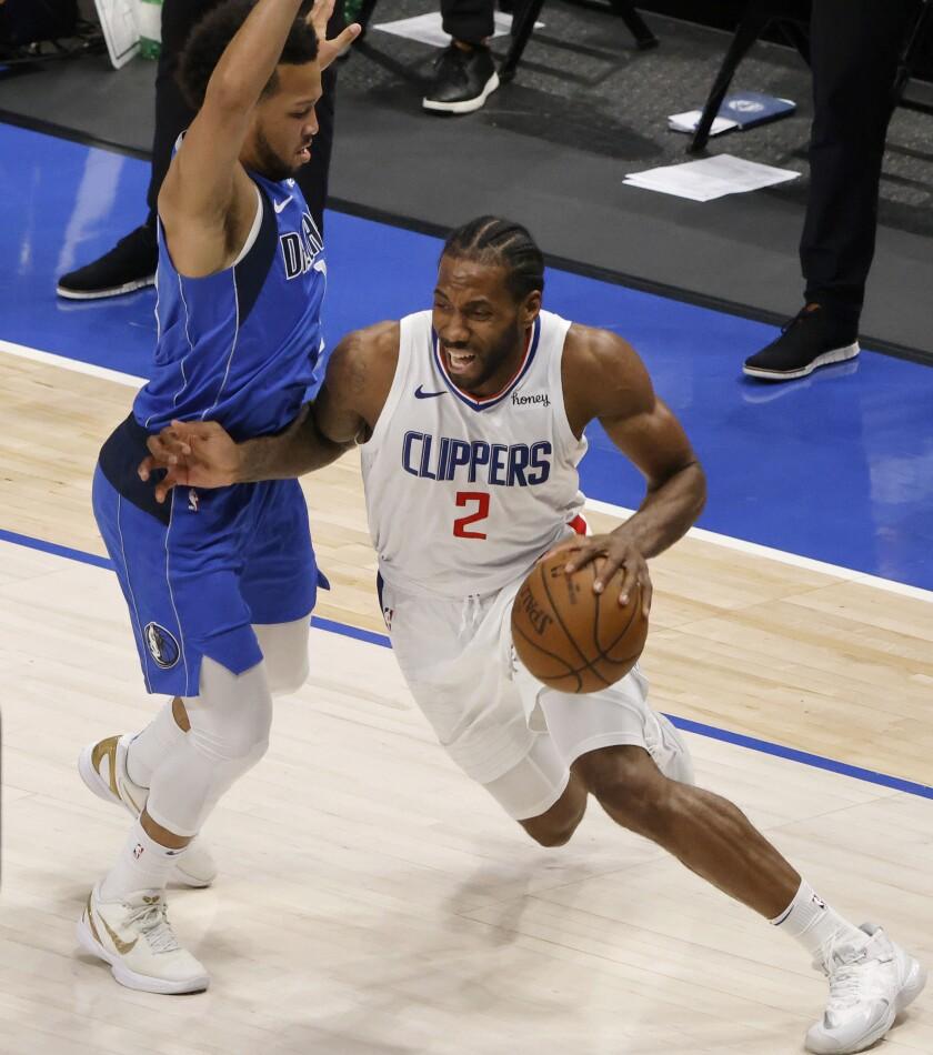 Clippers forward Kawhi Leonard (2) drives past Mavericks guard Jalen Brunson during Game 6 on Friday.