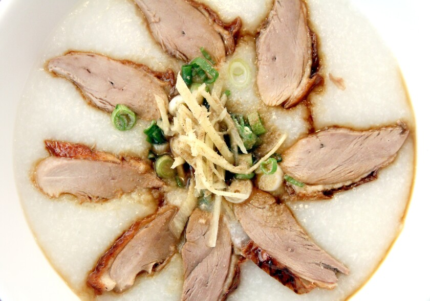 Sliced roasted duck porridge with scallions, ginger, pepper and a hint of soy sauce from Siam Sunset restaurant.