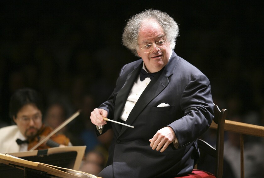 James Levine conducting the Boston Symphony Orchestra in Lenox., Mass. on July 7, 2006, served as the music director of New York's Metropolitan Opera from 1976 to 2016.