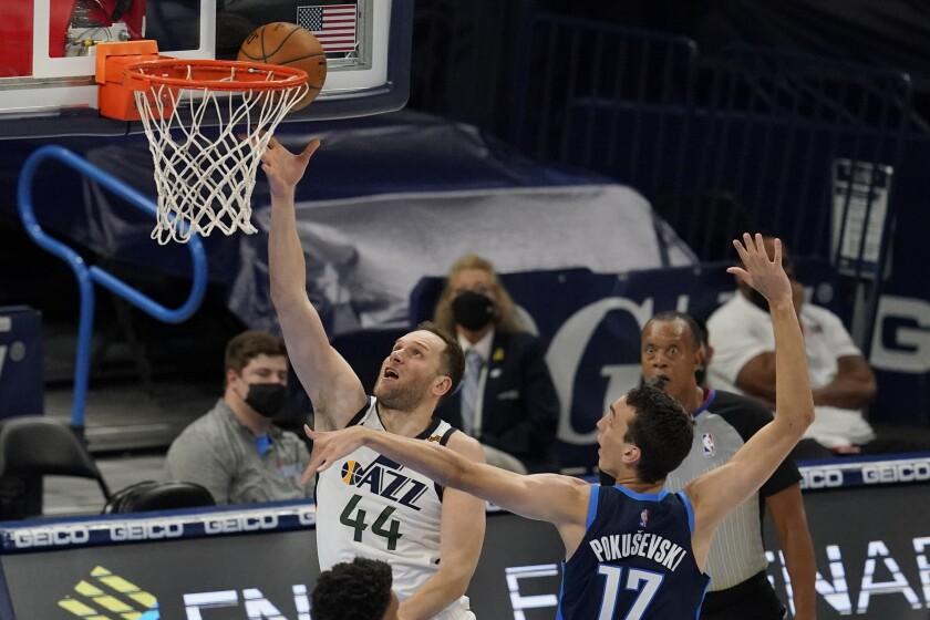 Utah Jazz forward Bojan Bogdanovic (44) shoots in front of Oklahoma City Thunder forward Aleksej Pokusevski (17) in the second half of an NBA basketball game Friday, May 14, 2021, in Oklahoma City. (AP Photo/Sue Ogrocki)