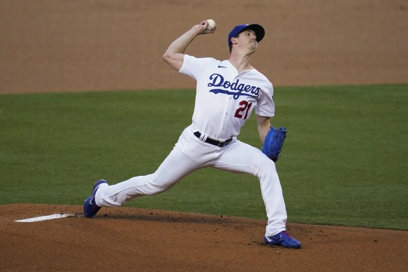 Dodgers pitcher Walker Buehler throws to an Arizona Diamondbacks batter.