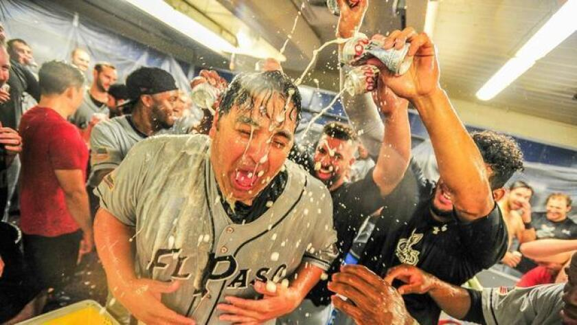 Rod Barajas and the El Paso Chihuahuas celebrate advancing to the 2016 Pacific Coast League championship series with a win over Tacoma.