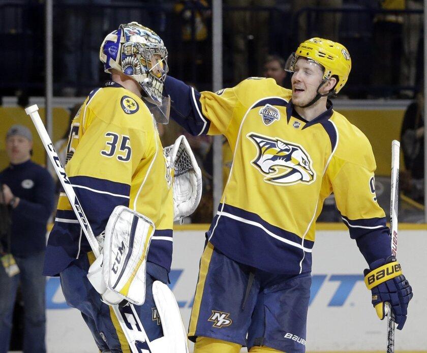 Nashville Predators center Ryan Johansen, right, congratulates goalie Pekka Rinne (35), of Finland, after beating the San Jose Sharks 6-2 in an NHL hockey game Saturday, Feb. 6, 2016, in Nashville, Tenn. (AP Photo/Mark Humphrey)