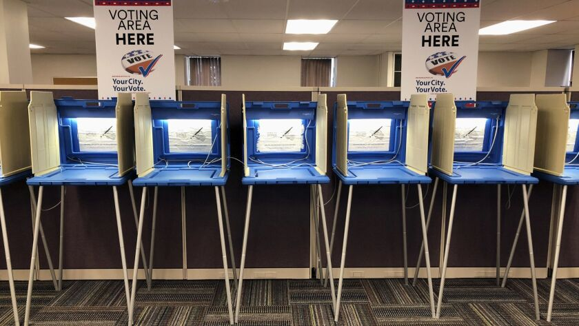 Voting booths stand ready in downtown Minneapolis on Thursday, Sept. 20, 2018, for Friday's opening
