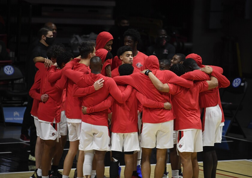 San Diego State basketball players huddle at Viejas Arena before playing Boise State last month.