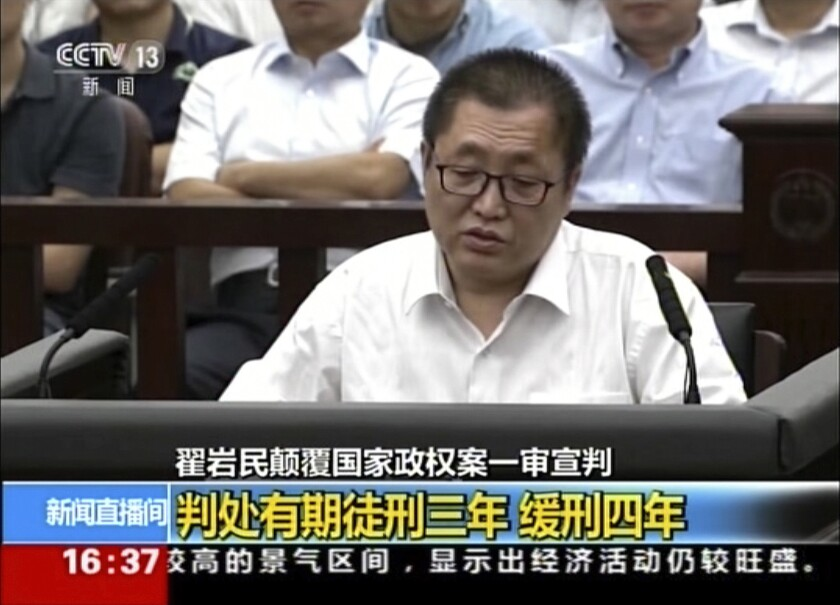 In an image from China's CCTV, Zhai Yanmin speaks during his trial at the Tianjin No. 2 Intermediate People's Court on Aug. 2.