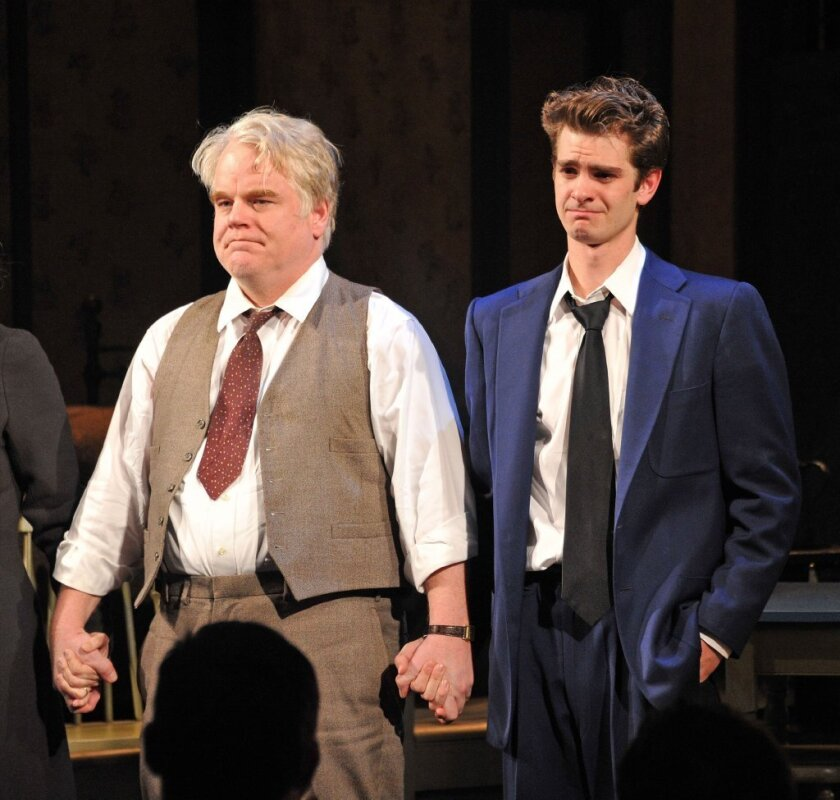 "Philip Seymour Hoffman at a curtain call for ""Death of a Salesman"" on Broadway, with costar Andrew Garfield."