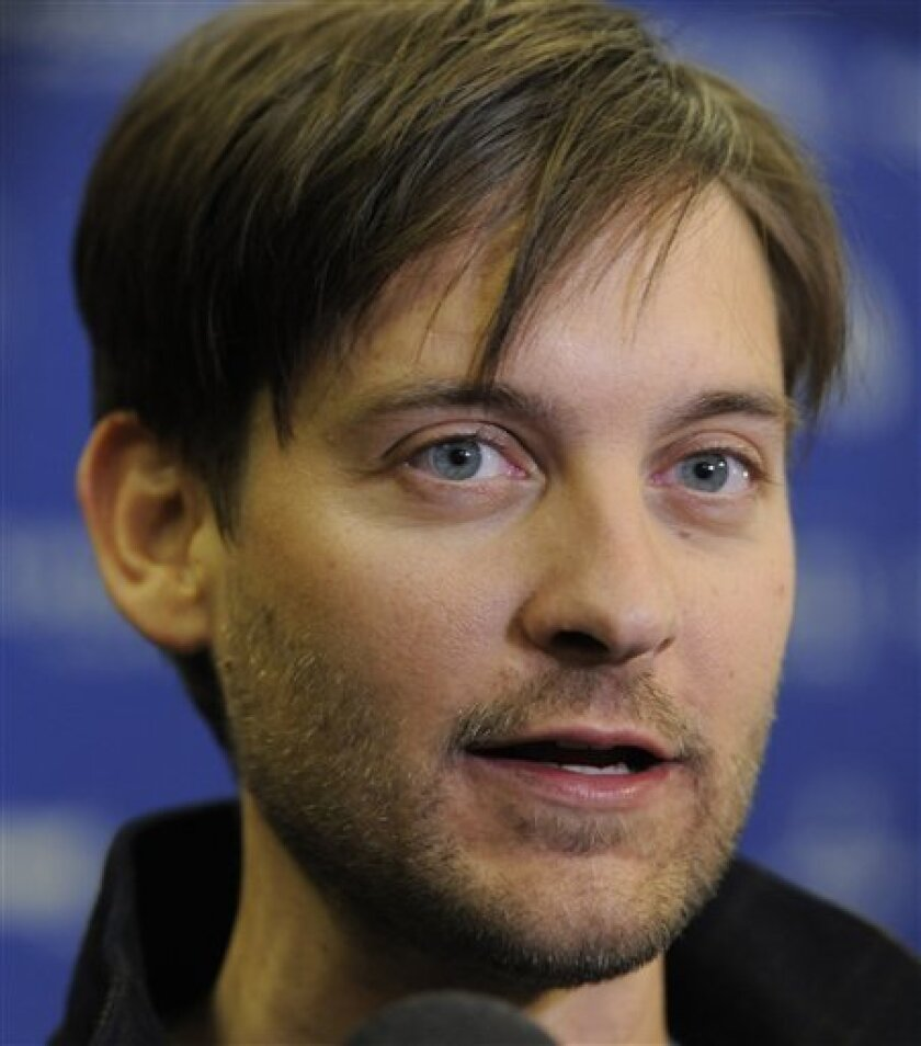 """FILE - In this Jan. 24, 2011 file photo, Tobey Maguire, a cast member in """"The Details,"""" is interviewed at the premiere of the film at the 2011 Sundance Film Festival in Park City, Utah. Maguire has denied wrongdoing by participating in poker games where he won more than $300,000 from a man convicte"""