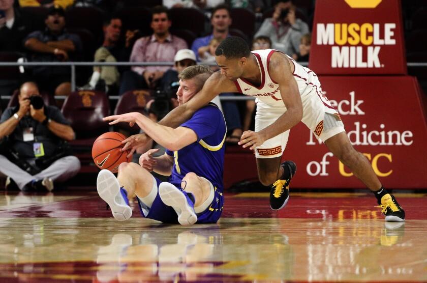 USC guard Elijah Weaver tries to steal the ball away from South Dakota State guard Baylor Scheierman.