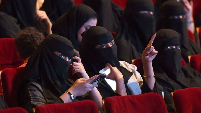 """Saudi women attend the """"Short Film Competition 2"""" festival at King Fahad Culture Center in Riyadh on Oct. 20."""