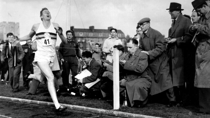 Roger Bannister nears the tape at the end of his record-breaking mile run at Iffley Road, Oxford.