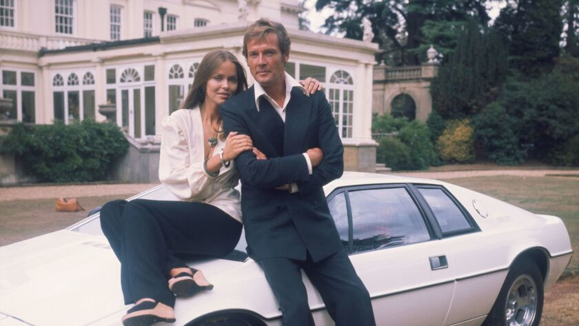 "1977: Barbara Bach and Roger Moore, stars of the James Bond movie ""The Spy Who Loved Me,"" leaning on the now-famous ""amphibious"" Lotus Esprit."