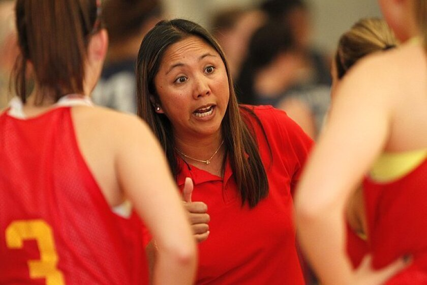 Stephanie Rivera, the new girls basketball coach at Cathedral Catholic High, guides her team during a summer game. The Dons return nine players from last year.