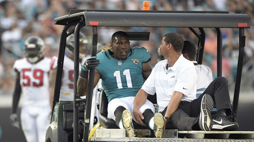 Jacksonville Jaguars wide receiver Marqise Lee (11) leaves the field on a medical cart after he was injured during the first half.