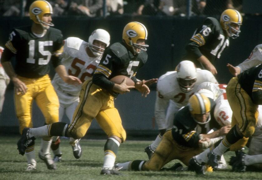 Green Bay Packers running back Paul Hornung (5)  runs against the Cardinals defense.