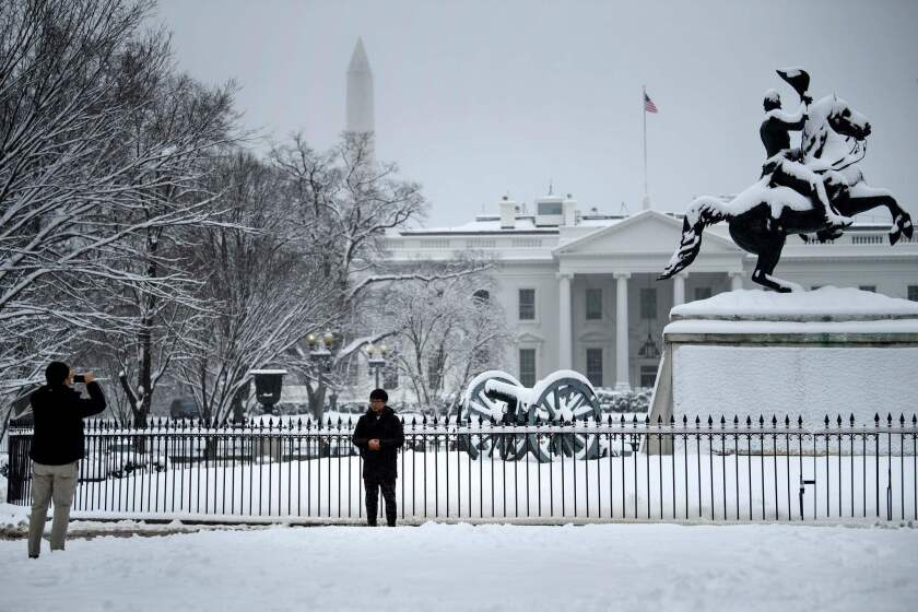 The White House, shown in this week's snow, was the intended target of a man arrested Wednesday in a sting, according to authorities.
