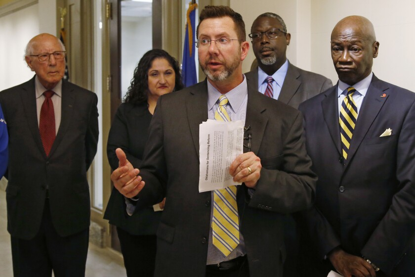 Former Republican House Speaker Kris Steele, the executive director of Oklahomans for Criminal Justice Reform, speaks after a group working to reduce Oklahoma's prison population launched an initiative petition that could lead to the release of hundreds more inmates, Tuesday, Nov. 12, 2019, in Oklahoma City. (AP Photo/Sue Ogrocki)