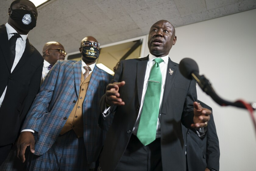 Ben Crump, the civil rights attorney representing the family of George Floyd, speaks to reporters